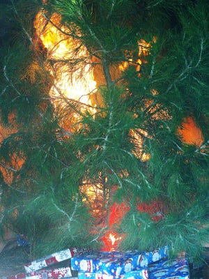 A Christmas tree is shown on fire in this file photo.