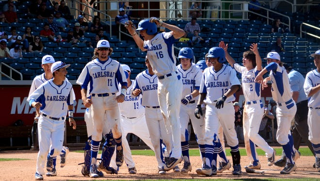 Carlsbad celebrates a two-run home run by Trevor Rogers (16) Friday against Volcano Vista.