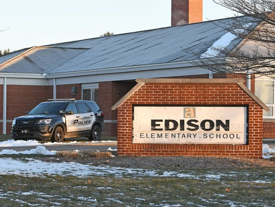 A police cruiser is parked outside Edison Elementary