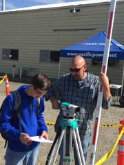 Learning about surveying as part of the Career Expo