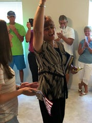 Linda Leonard celebrates as her daughter, Leah, looks on. The family has a new home in Bonita Springs thanks to Habitat for Humanity of Lee and Hendry Counties and the $50,000 sponsorship of another family, the Mulligans.