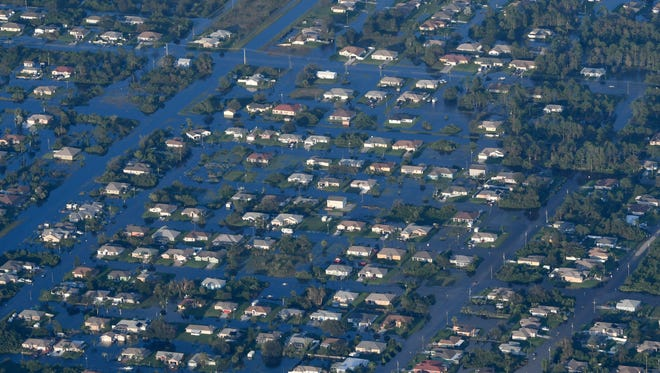 Water surrounds many of the homes like these in North Fort Myers after Hurricane Irma.  Mandatory Credit: Craig Bailey/FLORIDA TODAY via USA TODAY NETWORK