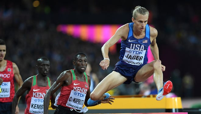 Evan Jager clears an obstacle as he competes in the final of the men's 3,000-meter steeplechase at the IAAF World Championships in London. Jager finished in third.