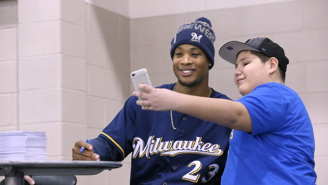 Xavier Bucio (right) takes a selfie with Brewers outfielder Keon Broxton during last year's event.