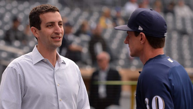 Milwaukee Brewers general manager David Stearns (left) and manager Craig Counsell will have some decisions to make in the upcoming MLB draft.