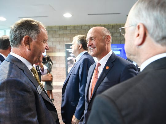 Reinhold Schmieding, left, Founder and President of Arthrex, talks with Clemson University President Jim Clements, and Tri-County Technical College President Ronnie Booth, before an Anderson County announcement of Anthrax at the Civic Center of Anderson on Monday.