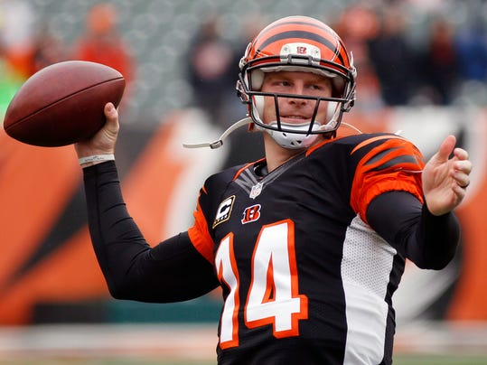 FILE - In this Dec. 29, 2013 file photo, Cincinnati Bengals quarterback Andy Dalton warms up prior to an NFL football game against the Baltimore Ravens, in Cincinnati. Dalton is comparing himself with some of the NFL's top quarterbacks while negotiating a contract extension with the Bengals. He knows the one stat that's holding him back: 0-3 in the postseason. (AP Photo/David Kohl, File)