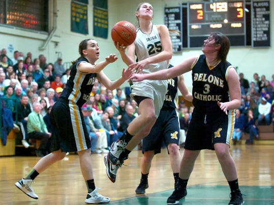 York Catholic's Morgan Klunk drives to the basket during Friday night's game against Delone Catholic. The Fighting Irish won, 57-44. (For the Daily Record/Sunday News -- Mike Zortman)