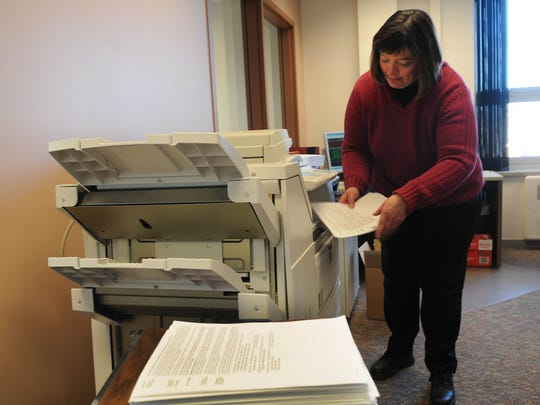 Door County Property Lister Holly Hansen attends to the printer that will run off more than 41,500 property bills over several days.