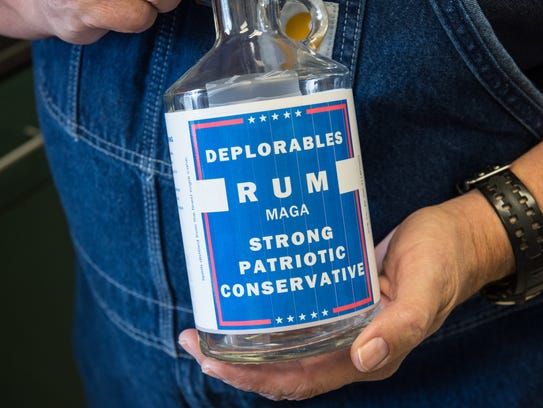 Tom Cropper, owner of Spirits of Patriots, holds a
