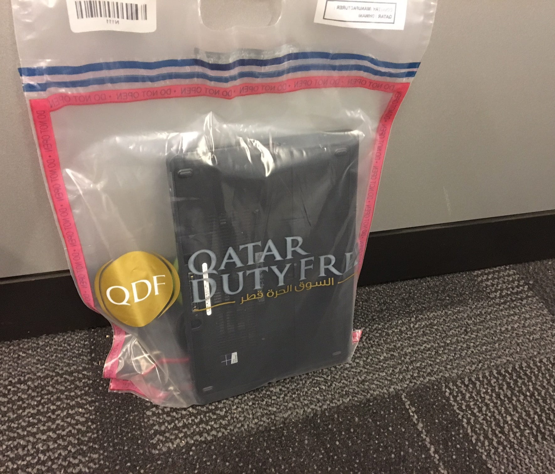 Qatar Airways swabs electronics in carry-on bags for direct flights to the U.S., for traces of explosives before sealing them in duty-free bags until the passenger is aboard the plane. This laptop was screened at the gate on July 12, 2017.