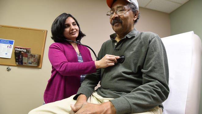 Dr. Dipali Desai listens to Wallace Thompson's heart beat Thursday afternoon at the Third Street Clinic in Shelby.
