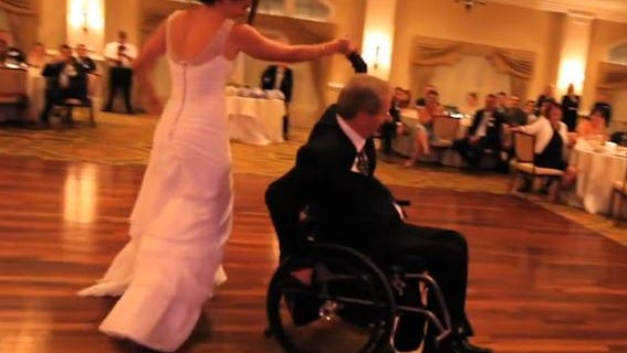 Paul Martin faced his fears and danced at his daughter's wedding in the wheelchair he's been in for the last 17 years.