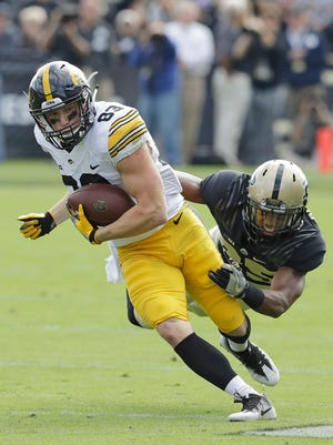 Iowa's Riley McCarron runs out of the tackle of Purdue's Antonio Blackmon during the first half.