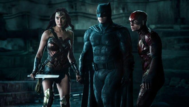 "Wonder Woman (far left, Gal Gadot), Batman (Ben Affleck) and the Flash (Ezra Miller) could use a little help from their super-friends in ""Justice League."""