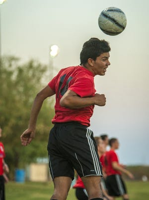 Luis Lopez of the Scottsdale 96 Blackhawks delivers a header during  practice.