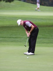 Genoa's Austin Marley putts in the NBC Championship at Green Hills.