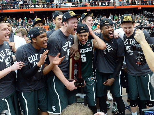 The Michigan State Spartans celebrates after the game