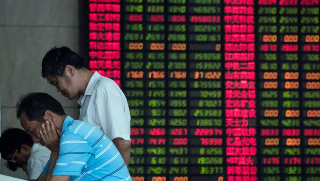 This photo taken on August 18, 2015 shows investors monitoring stock market movements at a brokerage house in Shanghai. Chinese shares were down more than seven percent in early trade on August 24, 2015 in the face of a global sell-off, despite Beijing authorising the state pension fund to invest in stocks in its latest attempt to shore up markets.   EISELEJOHANNES EISELE/AFP/Getty Images ORIG FILE ID: 543571766