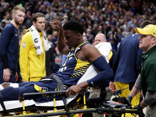 Indiana Pacers guard Victor Oladipo is taken off the court on a stretcher after he was injured during the first half of the team's NBA basketball game against the Toronto Raptors in Indianapolis, Wednesday, Jan. 23, 2019. (AP Photo/Michael Conroy) ORG XMIT: NAF107
