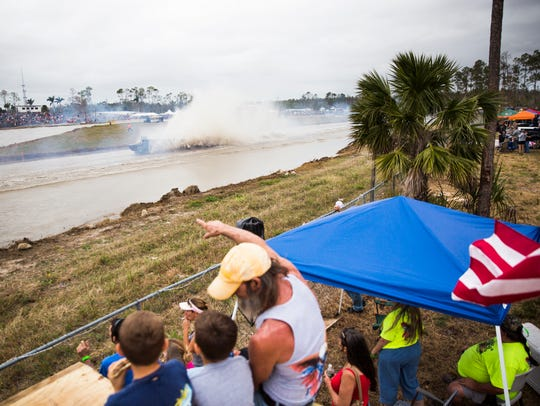 Tim Hubbard points to a swamp buggy during the Swamp Buggy Races Winter Classic in January at the Florida Sports Park.