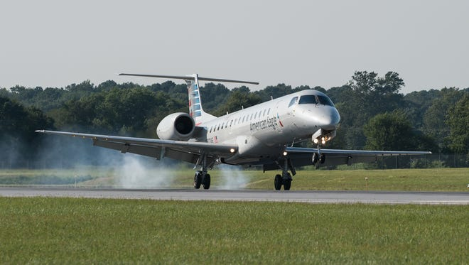 An Embraer-145 touches down at Salisbury Airport during the first commercial jet flight on Tuesday, Aug. 22, 2017.