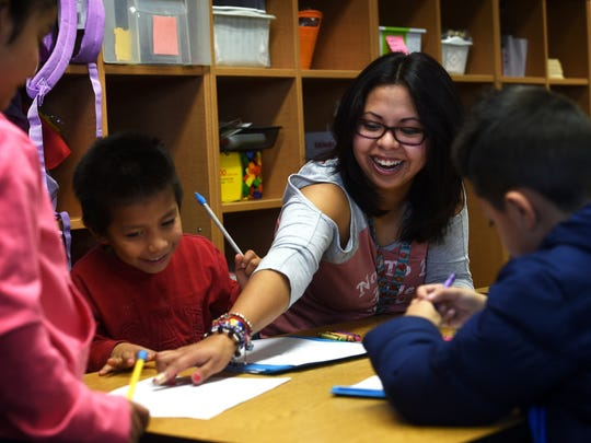 DACA student Maria Roberto works as a bilingual teaching aide at Libby C. Booth Elementary school in Reno on Feb. 7, 2017.