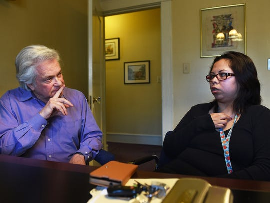 DACA student and resident of Reno Maria Roberto, right, meets with her attorney Richard D. Fleischer while filling out paperwork to renew her work permit in Reno on March 1, 2017.