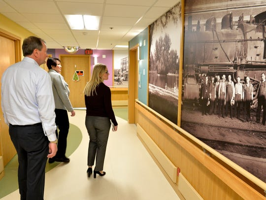 Benefis Health System CEO John Goodnow tours the memory care unit with Terry Pfeite, president of Benefis Spectrum Medical, Regional Relationships and Philanthropy, and Keri Garman Tang, a Benefis spokesperson.