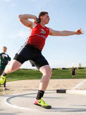 Valders senior Christopher Evenson throws shot put at the D2 regional track meet Monday, May. 22, 2017, in Valders.
