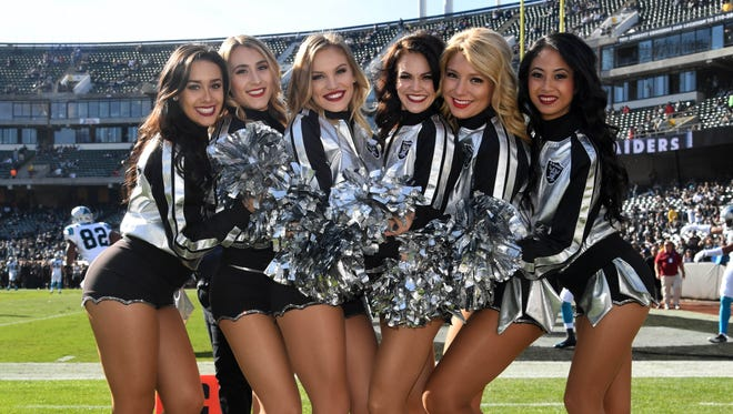 Oakland Raiders raiderette cheerleaders pose during a NFL football game against the Carolina Panthers at Oakland-Alameda County Coliseum.