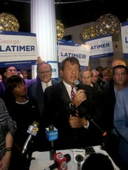 George Latimer speaks to supporters at the Coliseum