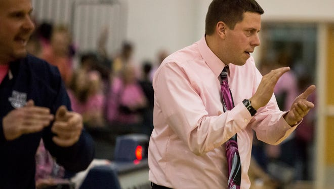 Marysville coach Ryan Rathje claps from the sidelines.