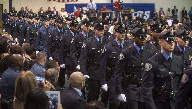 New officers graduate from the Camden County Police Academy in 2013. The department's hiring numbers fall below goal.