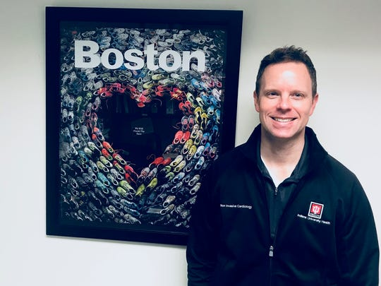 Dr. Michael Emery has a framed poster in his office -- a picture from Boston Magazine memorializing the 2013 race.