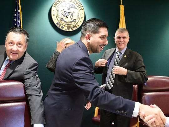 Center, Assad Akhter is sworn in as the first Muslim-American to hold a seat on the Passaic County Freeholder board.  Tariq Zehawi/NorthJersey.com