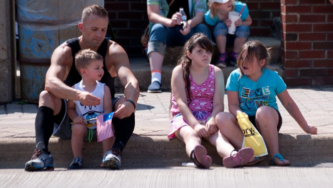 Attendees at a parade Saturday, June 18, 2016 during Yankee Doodle Days in downtown Grand Ledge.