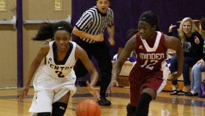 Minden's Bre Rogers (right) defends against Benton's Qua Chambers during a game last season. Both players have been key to their team's success so far this season.
