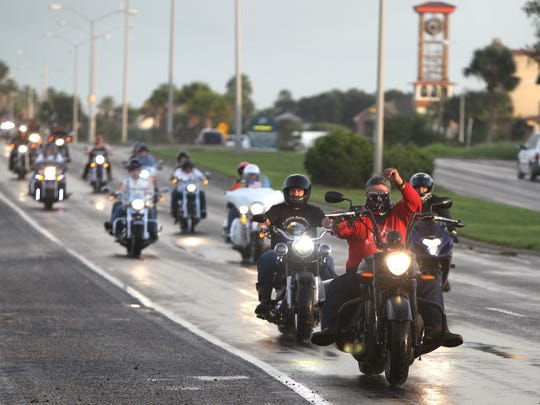 Motorcyclists ride down Ocean Drive as they participate in the Bikers and Badges BikeFest parade on Saturday, October 11, 2014. The parade was expanded from eight miles to 20 this year and began on Padre Island.