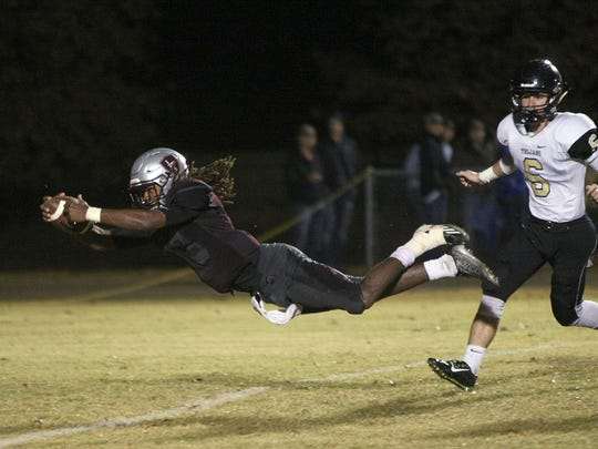 Liberty Tech's Corey Newble (13) dives into the end zone for a touchdown against Noah Watson (6) and Dyersburg during the Class 3A quarterfinals at Liberty Tech High School in Jackson, Tenn., on Friday, Nov. 18, 2016.