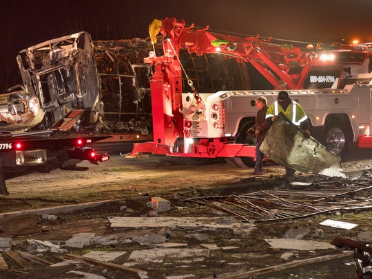 Emergency crews pick up debris from a collision Tuesday,