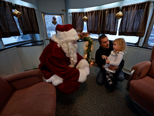 Kevin Klueger and his daughter Brylee, 2, from Mayville, Wis., visit with Santa Claus during The Polar Express event at the National Railroad Museum in Ashwaubenon.