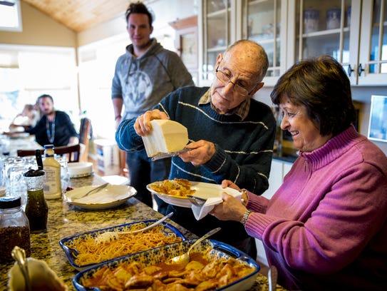 Joe Bonavita grates Parmesan cheese for Anna Bonavita