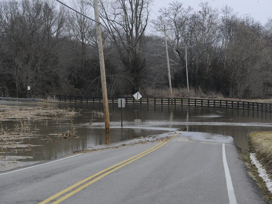 Flood waters from the Harpeth River cover Moran Road