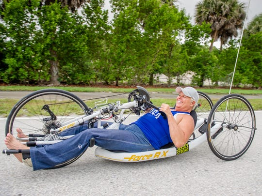 A runner, Jacqui Kapinowski continued to enter marathons as an able body person until age 35 when she became a wheelchair user. Pictured, she operates adaptive racing gear.