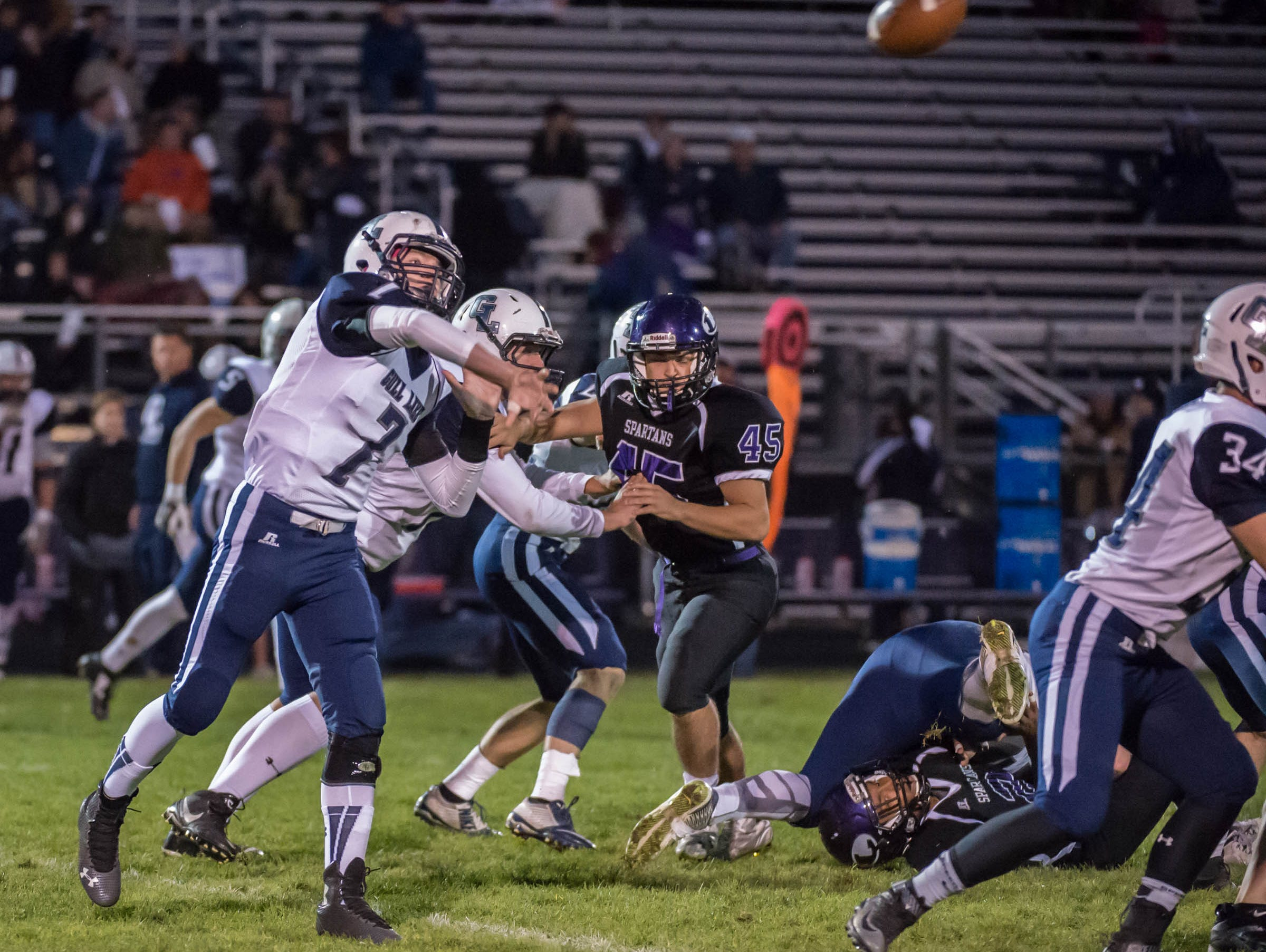 Gull Lake's Hunter Snyder (7) throws a pass during Friday's agme against Lakeview.