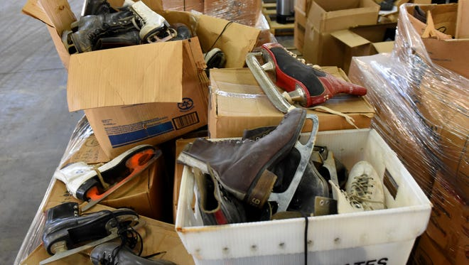 Boxes of old ice skates were among the things Tim Woods, manager of Knoxville's Gov-Deals, showed off during a tour of their operation Nov. 17, 2016.