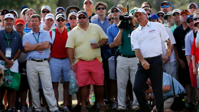 Fred Couples watches his shot back to the 17th hole during the second round of the 2014 The Masters golf tournament at Augusta National Golf Club.