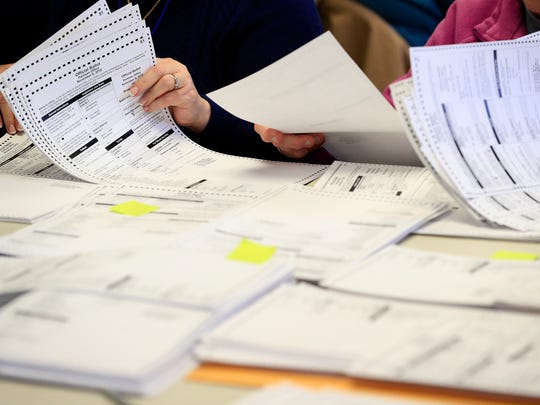 Workers sort through ballots on Thursday, December 1, 2016, in Ashwaubenon, Wis. A statewide recount of ballots began Thursday. Green Party Presidential Candidate Jill Stein's campaign paid the $3.5 million cost of the recount.Adam Wesley/USA TODAY NETWORK-Wisconsin