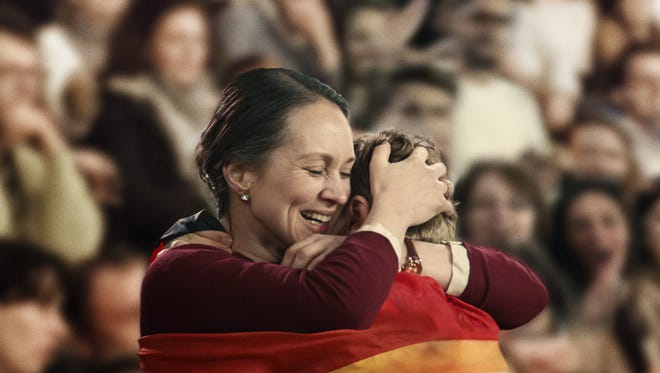 """A proud German mother hugs her victorious son after a race as part of Procter & Gamble's latest """"Thank You, Mom"""" ad campaign."""